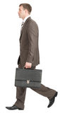 Businessman walking with suitcase Stock Image