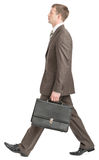 Businessman walking with suitcase Stock Photos