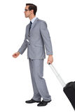 Businessman walking with suitcase Stock Photo