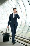 Businessman walking and talking on the phone Stock Photo