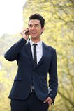 Businessman walking and talking on the phone Royalty Free Stock Images