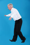 Businessman walking on tight-rope. Businessman walking on a tight-rope Royalty Free Stock Images