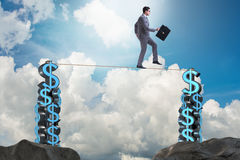 The businessman walking on tight rope Royalty Free Stock Photography