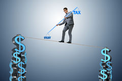 The businessman walking on tight rope Stock Images