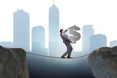 The businessman walking on tight rope Royalty Free Stock Photos