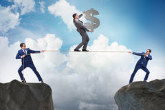 The businessman walking on tight rope Stock Photo