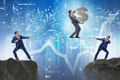 The businessman walking on tight rope Stock Photography