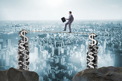 The businessman walking on tight rope Royalty Free Stock Images