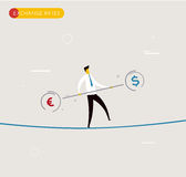 Businessman walking on tightrope balancing. Stock Photos