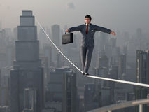 Businessman walking on Tightrope. Business man walking on Tightrope Royalty Free Stock Photo