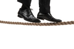 Businessman walking on tightrope on white background. Royalty Free Stock Photo