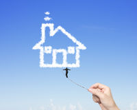 Businessman walking tightrope woman hand pulling toward house cl Stock Images