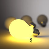 Businessman walking to growing lightbulb 3d. Idea diagram as success concept Stock Photography