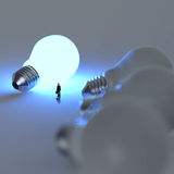 Businessman walking to growing  lightbulb 3d Royalty Free Stock Photos