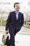 Businessman walking to office. Carrying briefcase Stock Photography