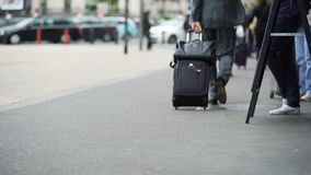 Businessman walking to train station with suitcase, business trip, travel. Stock footage stock video