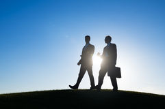 Businessman walking together conversation talking Stock Images