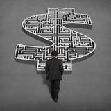 Businessman walking toward to 3d money shape maze Royalty Free Stock Photo