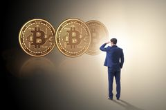 Businessman walking towards bitcoins in cryptocurrency blockchai. N concept Royalty Free Stock Image
