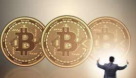 Businessman walking towards bitcoins in cryptocurrency blockchai. N concept stock image