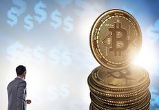 Businessman walking towards bitcoins in cryptocurrency blockchai. N concept royalty free stock photos
