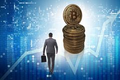 Businessman walking towards bitcoins in cryptocurrency blockchai. N concept stock photography