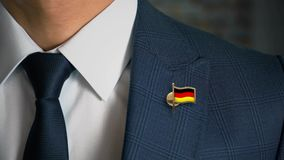 Businessman Walking Towards Camera With Country Flag Pin-Germany stock video footage