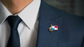 Businessman Walking Towards Camera With Country Flag Pin-Panama. In focus stock video footage