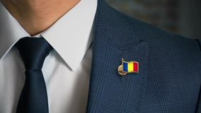 Businessman Walking Towards Camera With Country Flag Pin-Romania