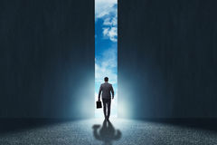 The businessman walking towards his ambition. Businessman walking towards his ambition royalty free stock images