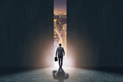 The businessman walking towards his ambition. Businessman walking towards his ambition stock photo