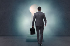 The businessman walking towards light from keyhole Stock Photography