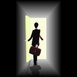 Businessman walking towards open the door showing  Royalty Free Stock Image
