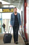 Businessman Walking at Train Station Royalty Free Stock Photography