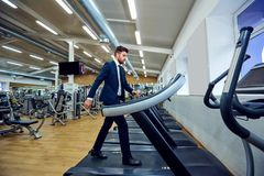 A businessman is walking on a treadmill. Stock Photography