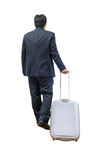 Businessman walking with trolley and bag. Business travel, isolated on white background Stock Photos