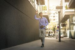 Businessman walking trough street. royalty free stock images