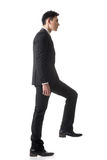 Businessman walking up Stock Photo