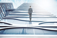 Businessman walking up glass building. Abstract image of businessman walking up glass building on sky background. 3D Rendering Stock Image