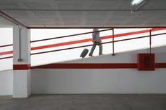 Businessman Walking Up Ramp With Luggage In Parking Garage Royalty Free Stock Photos