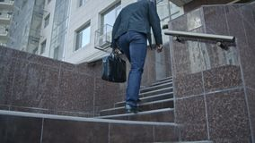Businessman Walking Up The Stairs With His Bag stock footage