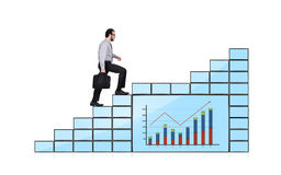 Businessman walking up Stock Image