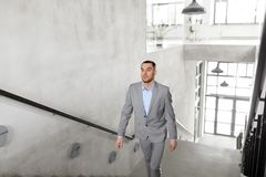 Businessman walking upstairs. Business, success and career lift concept - businessman walking upstairs Royalty Free Stock Photography