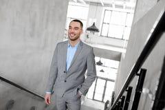Businessman walking upstairs. Business, success and career lift concept - businessman walking upstairs Royalty Free Stock Photo