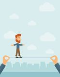 Businessman walking on wire Royalty Free Stock Photography