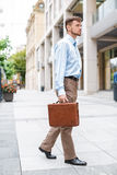Businessman walks with briefcase Royalty Free Stock Image