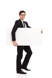 Businessman walks with placard. Stock Photo