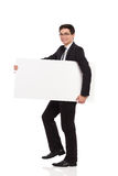 Businessman walks with placard. Royalty Free Stock Images