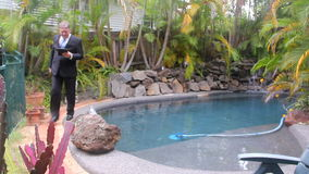 Businessman Walks By Pool Royalty Free Stock Images