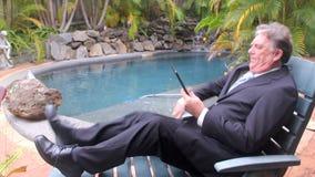 Businessman Walks By Pool stock footage
